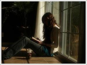 woman reading by window